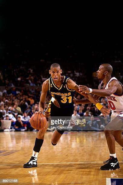 Reggie Miller of the Indiana Pacers drives to the basket against Greg Anthony of the New York Knicks in Game Five of the Eastern Conference...