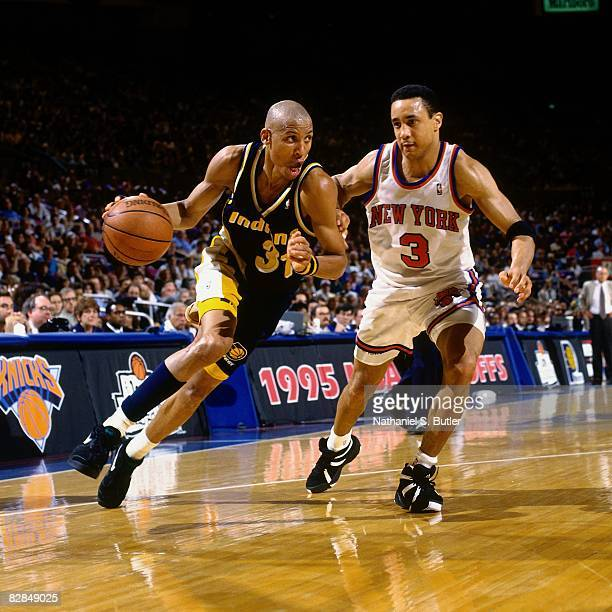 Reggie Miller of the Indiana Pacers drives to the basket against John Starks of the New York Knicks in Game Seven of the 1995 Eastern Conference...