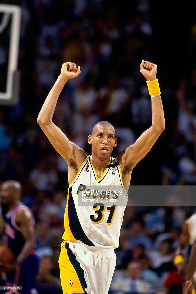 Reggie Miller #31 of the Indiana Pacers holds his arms in the air in Game Four of the Eastern Conference Finals against the New York Knicks during the 1994 NBA Playoffs at Market Square Arena on May 30, 1994 in Indianapolis, Indiana. The Pacers won 83-77.