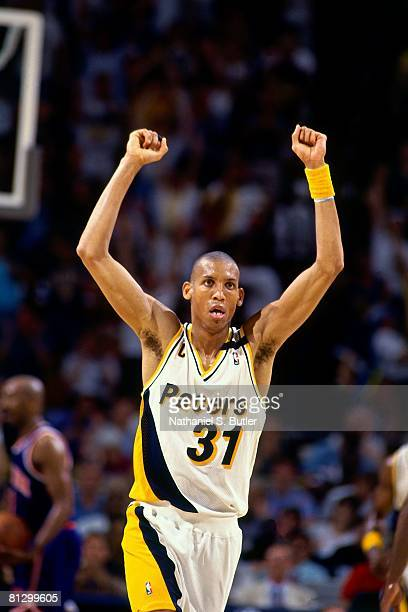 Reggie Miller of the Indiana Pacers holds his arms in the air in Game Four of the Eastern Conference Finals against the New York Knicks during the...