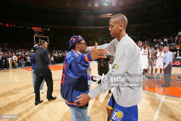 Reggie Miller of the Indiana Pacers hugs director Spike Lee after Miller's last game against the New York Knicks on April 5 2005 at Madison Square...