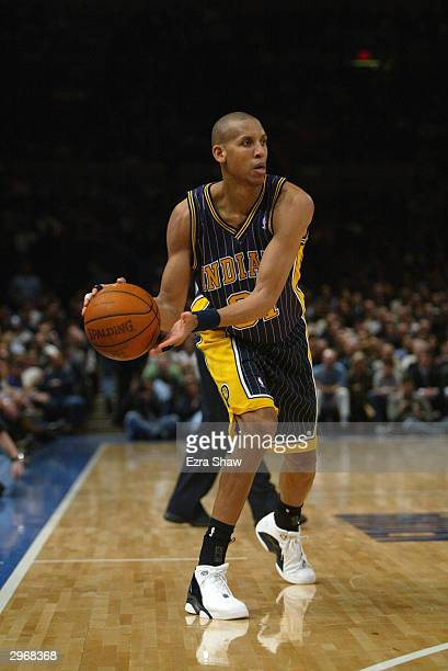 Reggie Miller of the Indiana Pacers looks to pass the ball during the game against the New York Knicks at Madison Square Garden on February 3 2004 in...