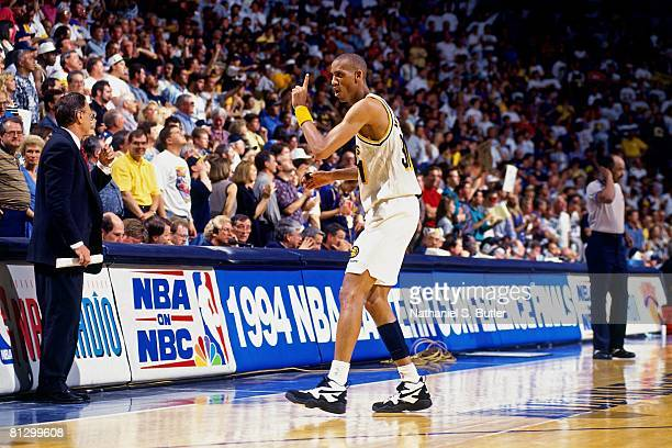 Reggie Miller of the Indiana Pacers points his finger in Game Four of the Eastern Conference Finals against the New York Knicks during the 1994 NBA...
