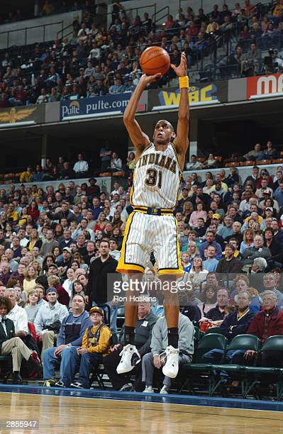 Reggie Miller of the Indiana Pacers shoots a 3pointer during the game against the New Orleans Hornets on January 3 2004 at Conseco Fieldhouse in...
