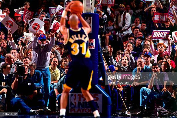 Reggie Miller of the Indiana Pacers shoots a free-throw in Game One of the Eastern Conference Semifinals against the New York Knicks during the 1995...