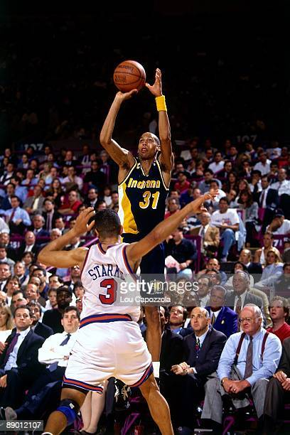 Reggie Miller of the Indiana Pacers shoots a jump shot against John Starks of the New York Knicks in Game Five of the Eastern Conference Semifinals...