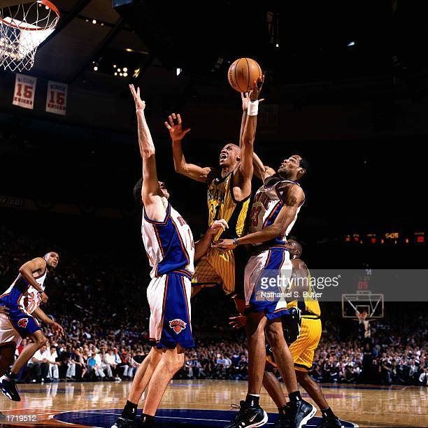 Reggie Miller of the Indiana Pacers shoots a jumpshot in the lane during the NBA game against the New York Knicks at Madison Square Garden in 1999 in...