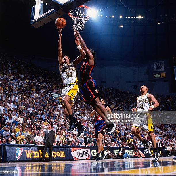 Reggie Miller of the Indiana Pacers shoots a layup against Latrell Sprewell of the New York Knicks in Game Two of the Eastern Conference Finals...