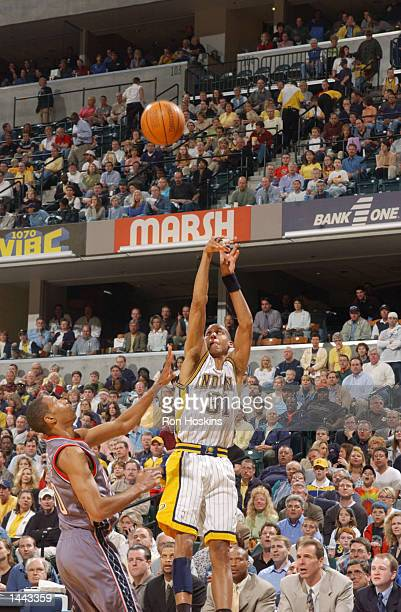Reggie Miller of the Indiana Pacers shoots a three pointer against the New Jersey Nets during game 3 of the Eastern Conference Quarter Finals series...