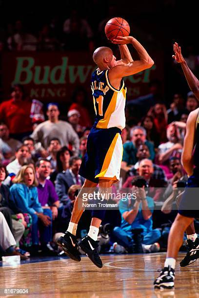 Reggie Miller of the Indiana Pacers shoots a three-pointer in Game One of the Eastern Conference Semifinals against the New York Knicks during the...