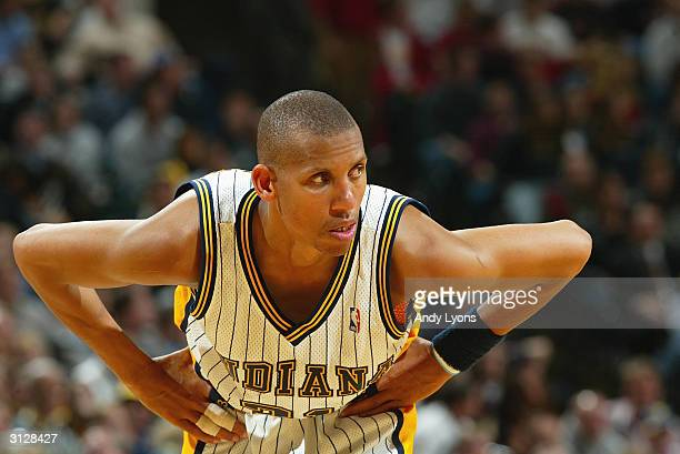 Reggie Miller of the Indiana Pacers stands on the court during the game against the Toronto Raptors at Conseco Fieldhouse on March 9, 2004 in...