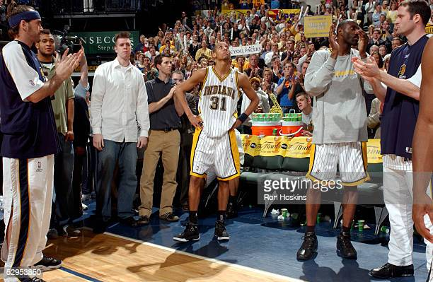 Reggie Miller of the Indiana Pacers takes in a standing ovation after coming out of his last career NBA game, in the final seconds against the...