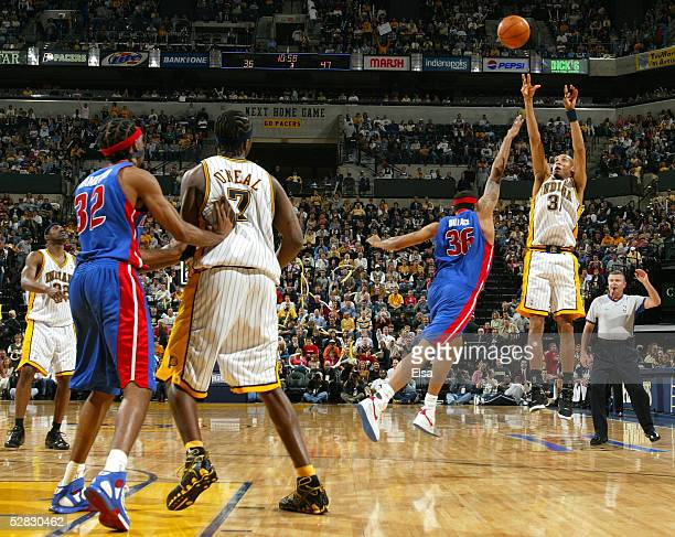Reggie Miller of the the Indiana Pacers tries to get a three point shot off as Rasheed Wallace of the Detroit Pistons defends in Game four of the...