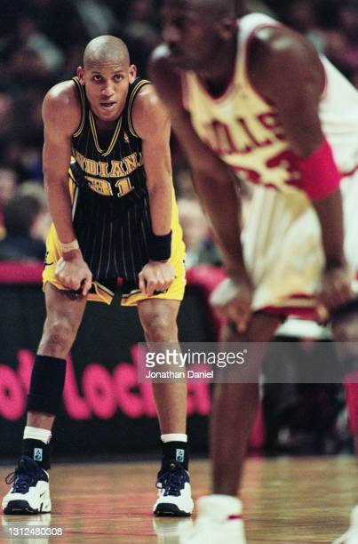 Reggie Miller, Shooting Guard for the Indiana Pacers looks over to Michael Jordan of the Chicago Bulls during their NBA Central Division basketball...
