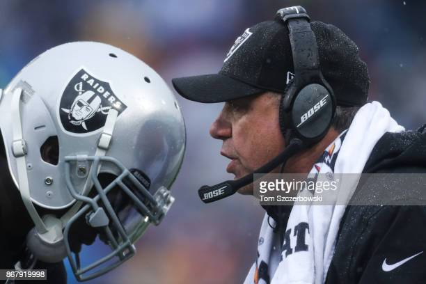 Reggie Nelson of the Oakland Raiders listens as head coach Jack Del Rio of the Oakland Raiders talks to him during the first quarter of an NFL game...
