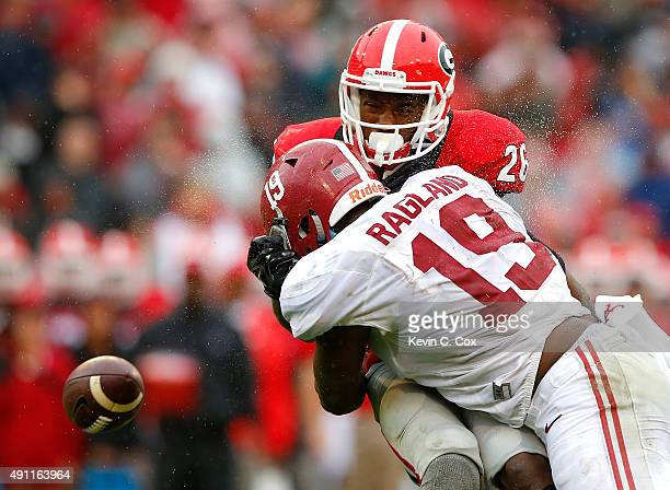 Reggie Ragland of the Alabama Crimson Tide breaks up a reception as he tackles Malcolm Mitchell of the Georgia Bulldogs at Sanford Stadium on October...