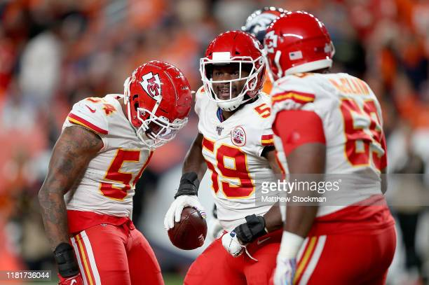 Reggie Ragland of the Kansas City Chiefs and teammates celebrate his touchdown after the recovery of a fumble by the Denver Broncos in the game at...