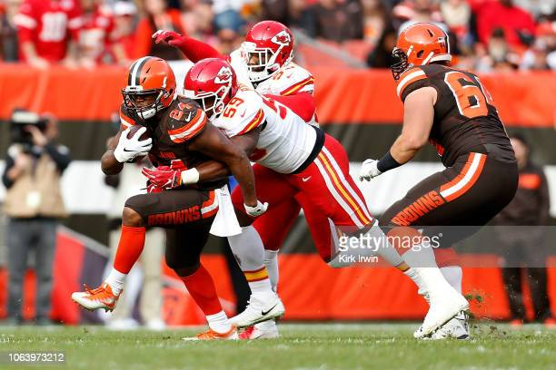 Reggie Ragland of the Kansas City Chiefs attempts to tackle Nick Chubb of the Cleveland Browns during the game at FirstEnergy Stadium on November 4...
