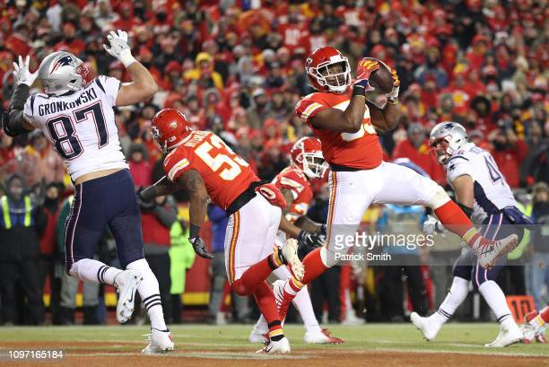 Reggie Ragland of the Kansas City Chiefs intercepts a pass in the second quarter against the New England Patriots during the AFC Championship Game at...