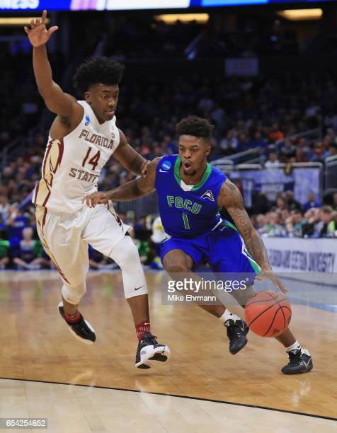 Reggie Reid of the Florida Gulf Coast Eagles drives against Terance Mann of the Florida State Seminoles in the first half during the first round of...