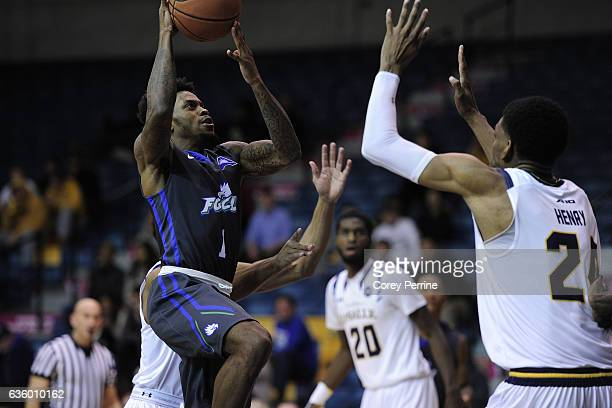 Reggie Reid of the Florida Gulf Coast Eagles drives to the hoop against Demetrius Henry of the La Salle Explorers during the second half at Tom Gola...