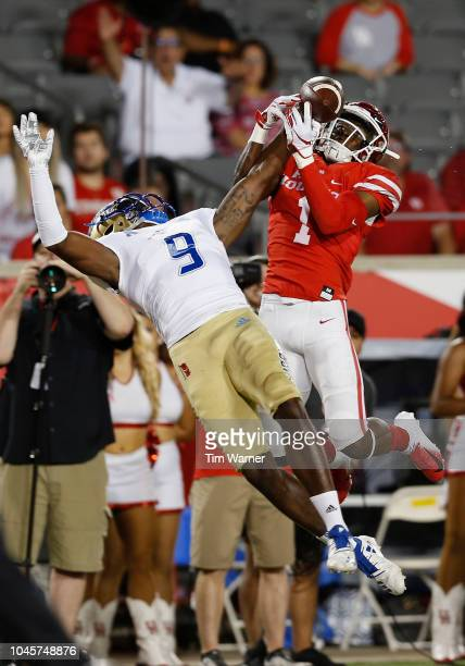 Reggie Robinson II of the Tulsa Golden Hurricane breaks up a pass intended for Bryson Smith of the Houston Cougars in the endzone during the first...