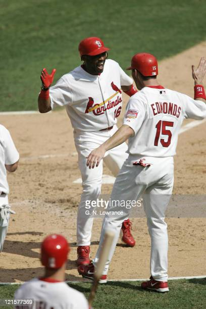 Reggie Sanders and Jim Edmonds of the St Louis Cardinals celebrate after a grand slam from Sanders against the San Diego Padres during Game 1 of the...