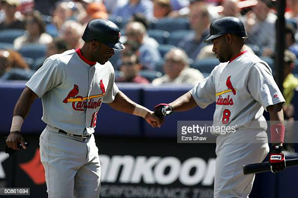 Reggie Sanders is congratulated by Marlon Anderson of the St Louis Cardinals after he scored to give the Cardinals a 43 lead over the New York Mets...