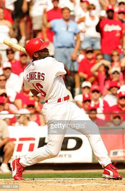 Reggie Sanders of the St. Louis Cardinals hits a grand slam in the fifth inning bringing in teammates Jim Edmonds, Albert Pujols and Larry Walker...