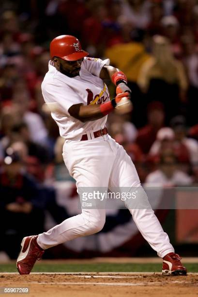 Reggie Sanders of the St. Louis Cardinals strikes out in the fourth inning of Game Six of the National League Championship Series against the Houston...