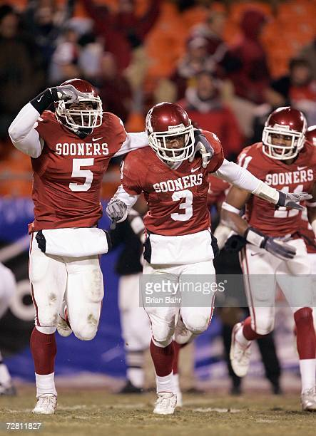 Reggie Smith and Nic Harris of the Oklahoma Sooners celebrate on the field against the Nebraska Cornhuskers during the 2006 Dr Pepper Big 12...