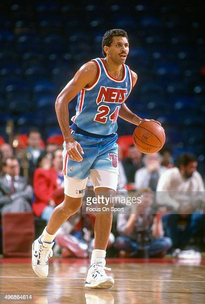 Reggie Theus of the New Jersey Nets dribbles the ball against the Washington Bullets during an NBA basketball game circa 1991 at the Capital Centre...