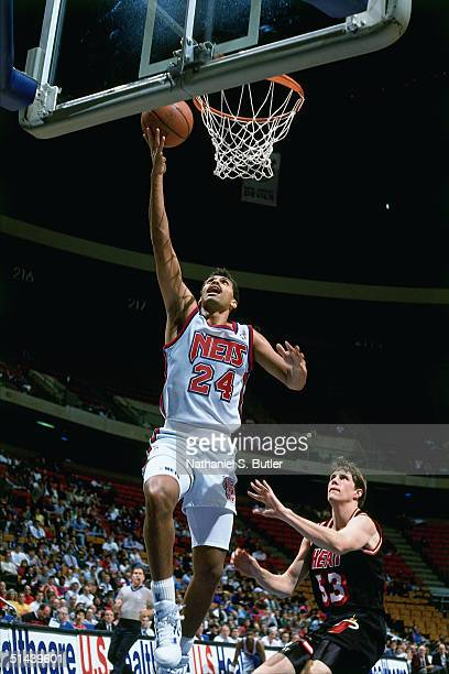 Reggie Theus of the New Jersey Nets drives to the basket for a layup against the Miami Heat during a NBA game at the Brendan Byrne Arena in 1991 in...