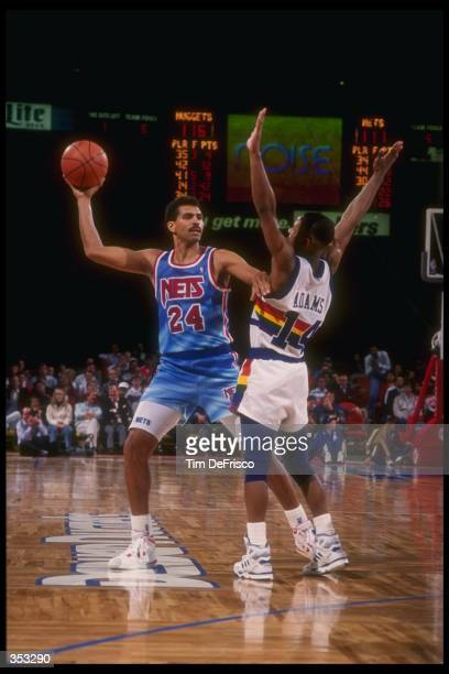 Reggie Theus of the New Jersey Nets looks to pass the ball during a game Mandatory Credit Tim DeFrisco /Allsport Mandatory Credit Tim DeFrisco...
