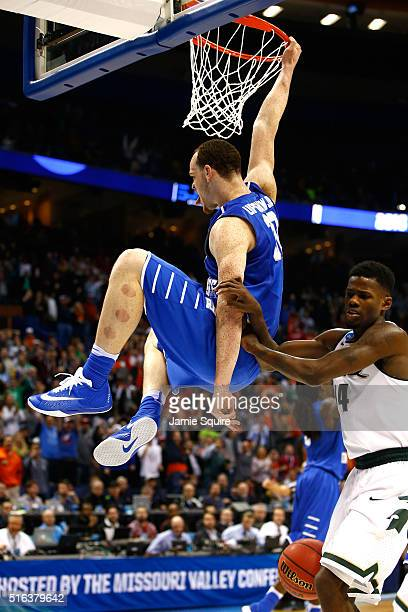 Reggie Upshaw of the Middle Tennessee Blue Raiders dunks late in the game against the Michigan State Spartans during the first round of the 2016 NCAA...