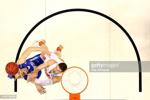 Reggie Upshaw of the Middle Tennessee Blue Raiders goes up with the ball against Tyler Lydon of the Syracuse Orange in the first half during the...