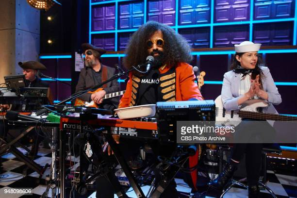Reggie Watts and Karen the Late Late Show band with members Steve Scalfati Tim Young and Hagar Ben Ari performs during the sketch Ships Ahoy during...