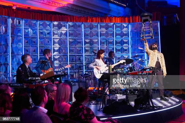 Reggie Watts and Karen the Late Late Show band with members Steve Scalfati Tim Young Hagar Ben Ari and Guillermo Brown performs during The Late Late...