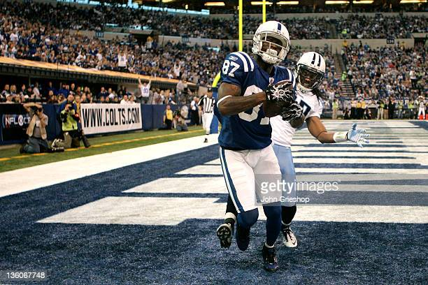 Reggie Wayne of the Indianapolis Colts hauls in the touchdown reception during the game against the Tennessee Titans at Lucas Oil Stadium on December...
