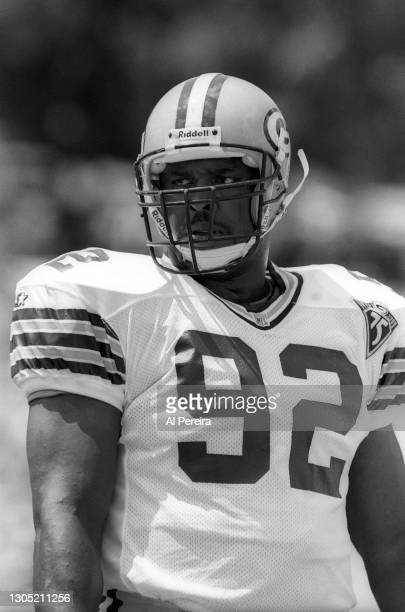 Reggie White of the Green Bay Packers plays against the Los Angeles Raiders at the Pro Football Hall of Fame Game at Fawcett Stadium on July 31, 1993...