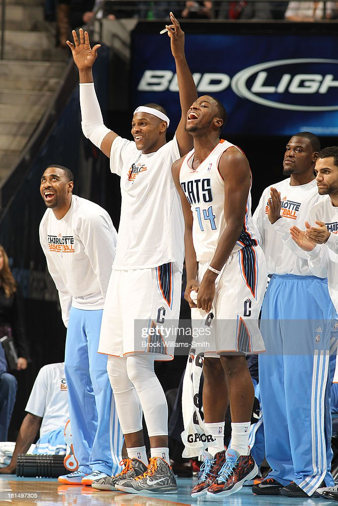 Reggie Williams #55, Brendan Haywood #33, and Michael Kidd-Gilchrist #14 of the Charlotte Bobcats celebrate on the bench during the game against the Boston Celtics at the Time Warner Cable Arena on February 11, 2013 in Charlotte, North Carolina.