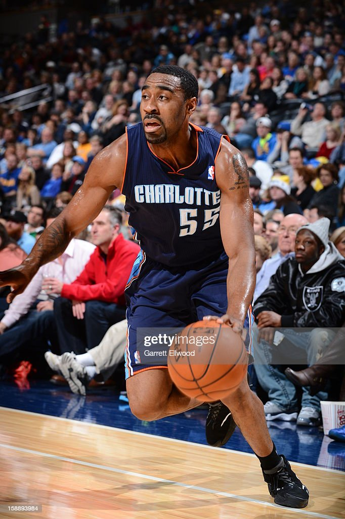 Reggie Williams #55 of the Charlotte Bobcats drives against the Denver Nuggets on December 22, 2012 at the Pepsi Center in Denver, Colorado.