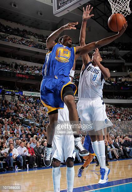 Reggie Williams of the Golden State Warriors goes in for the layup against Alexis Ajinca of the Dallas Mavericks during a game on December 7 2010 at...
