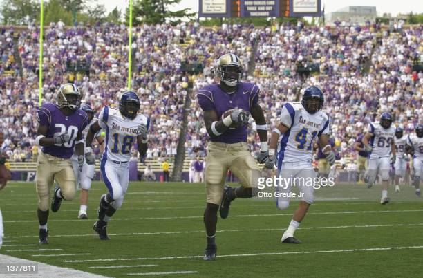 Reggie Williams of the Washington Huskies scores the longest pass reception for a touchdown in Huskie history against the San Jose State Spartans...