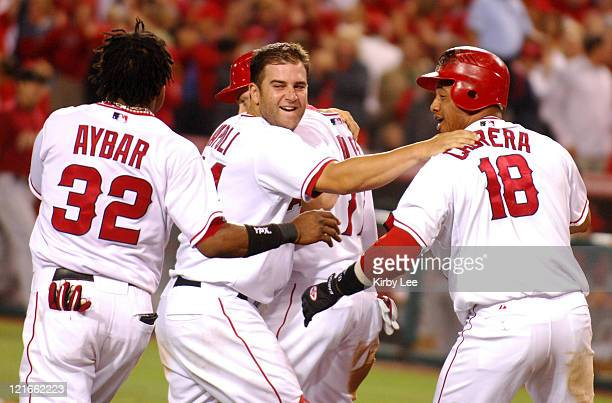 Reggie Willits is congratulated by Erick Aybar Mike Napoli and Orlando Cabrera after scoring the winning run in the ninth inning of 109 victory over...