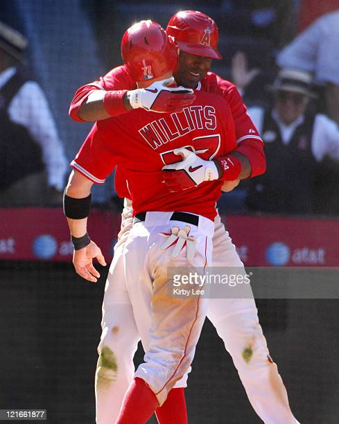 Reggie Willits is embraced by Gary Matthews Jr in celebration after scoring the winning run in the 10th inning of 98 victory over the Detroit Tigers...
