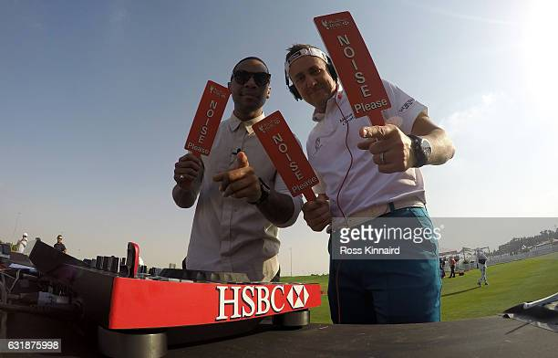 Reggie Yates and Ian Poulter of England during a photocall on the driving range prior to the Abu Dhabi HSBC Championship at Abu Dhabi Golf Club on...