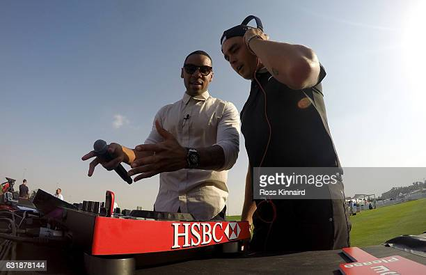 Reggie Yates and Rickie Fowler of the USA during a photocall on the driving range prior to the Abu Dhabi HSBC Championship at Abu Dhabi Golf Club on...