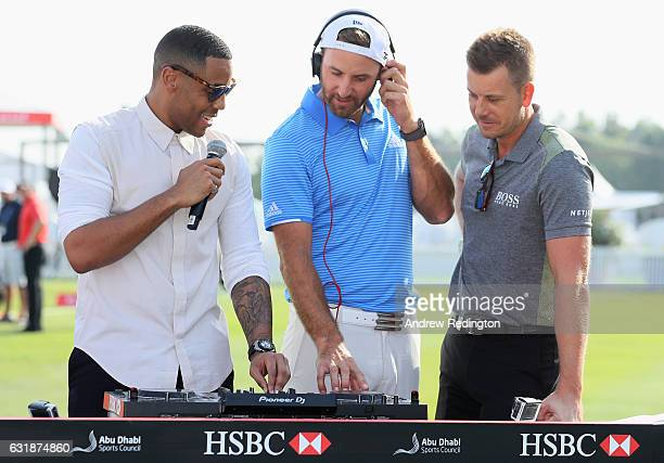 DJ Reggie Yates with Dustin Johnson of the USA and Henrik Stenson of Sweden during a photocall on the driving range prior to the Abu Dhabi HSBC...