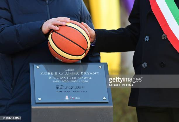 Reggio Emilia mayor Luca Vecchi and Stefano Landi unveil the commemorative plaque during the inauguration ceremony of a square named after late Los...
